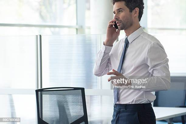 Businessman at office using cell phone