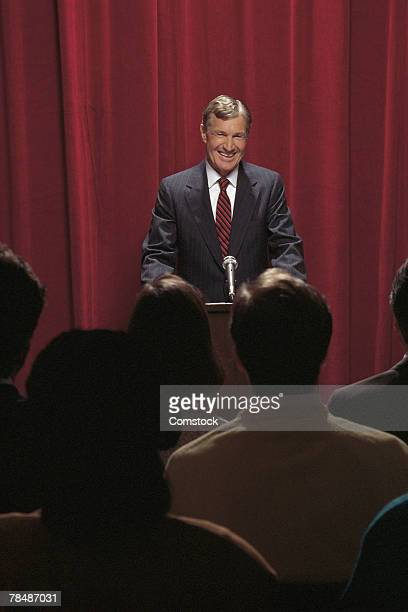 Businessman at podium in front of audience