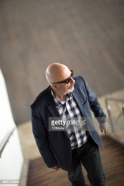 Businessman At Stairs