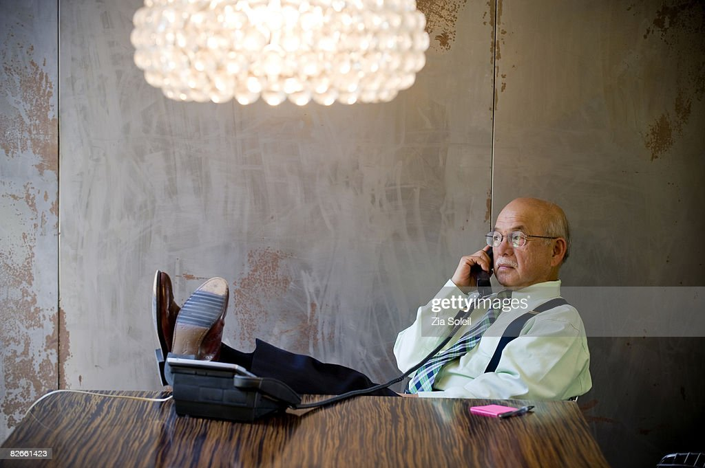 businessman at table on phone, : Stock Photo