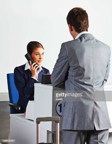 Businessman at the airport check in counter