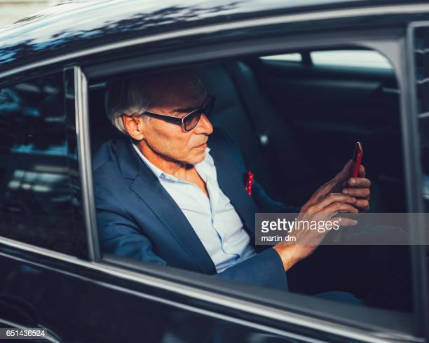 Businessman at the backseat of a taxi