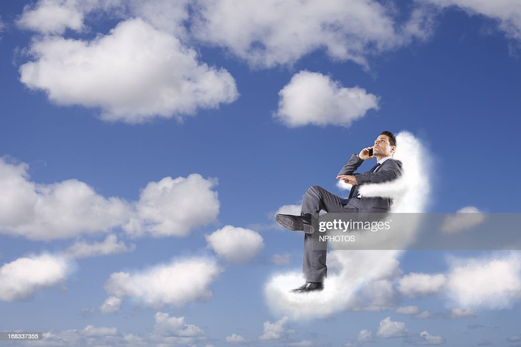 Businessman at the cloud : Stock Photo