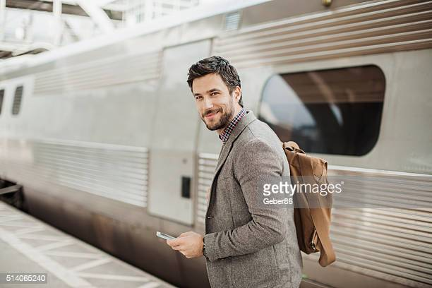 Businessman at train station