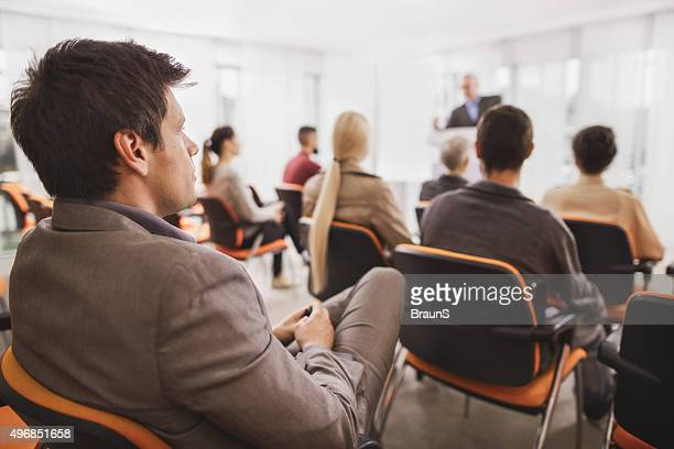 Businessman attending a business seminar at board room.