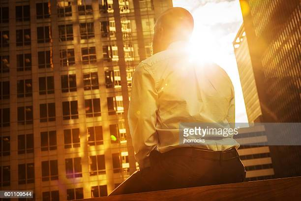 Businessman Bathed in Sunlight