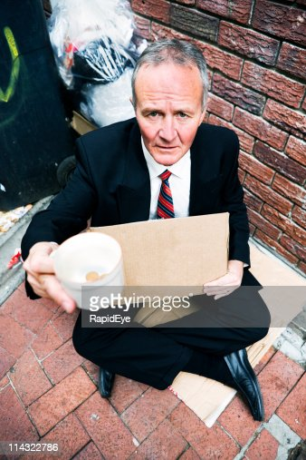Businessman begging
