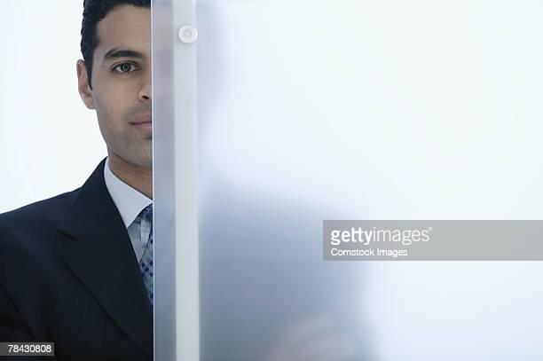 Businessman behind glass
