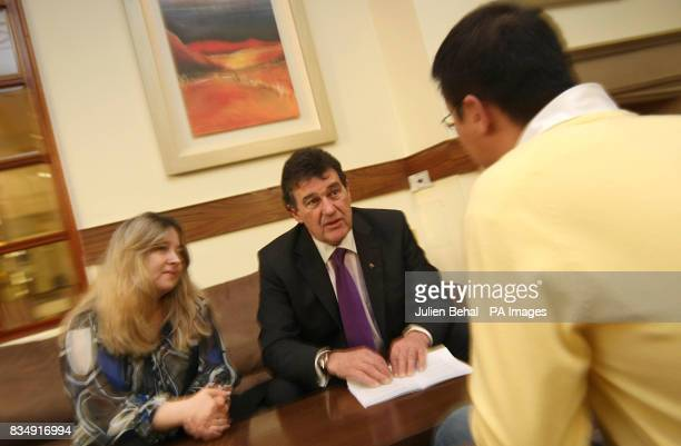 Businessman Bill Cullen talks with Chinese National Junyu Wang and Viola Di Bucchianico as the Immigrant Council of Ireland launches its scheme at...