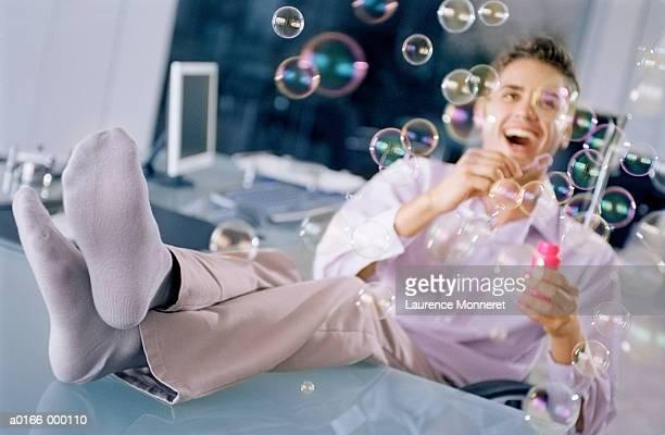 Businessman Blowing Bubbles