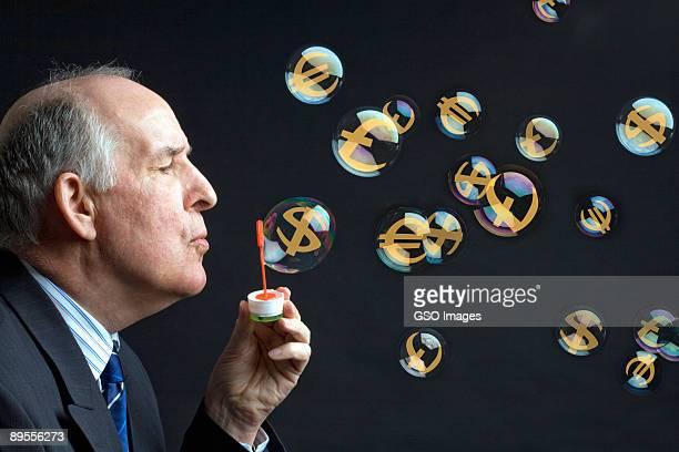 Businessman blows bubbles