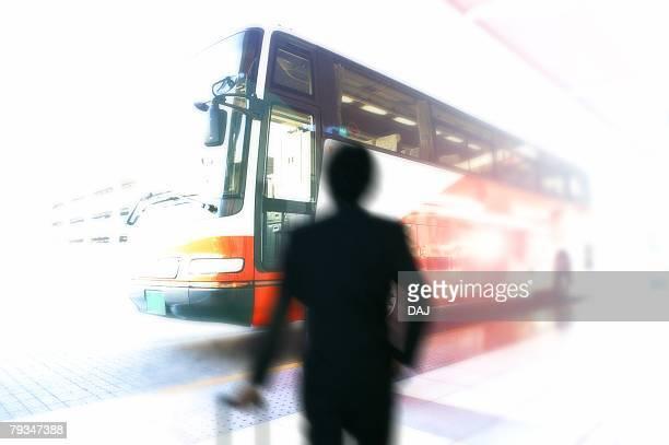 Businessman boarding airport bus