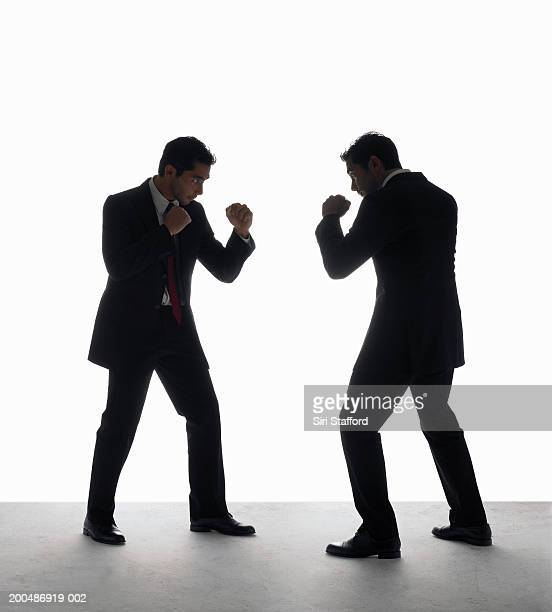 Businessman boxing with himself