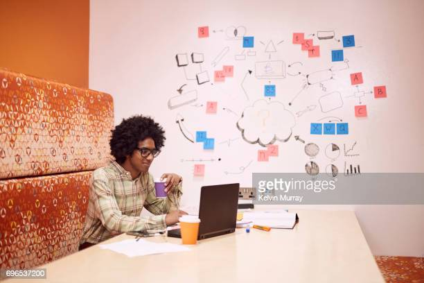 Businessman brainstorming in creative office