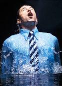 businessman breaking the watersurface