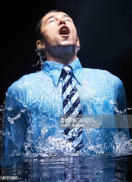 businessman breaking the watersurface