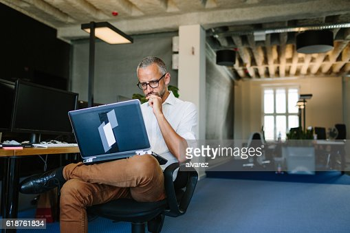 Businessman busy working on laptop