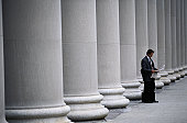 Businessman by Columns