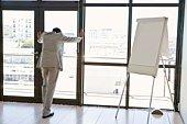 Businessman by note board