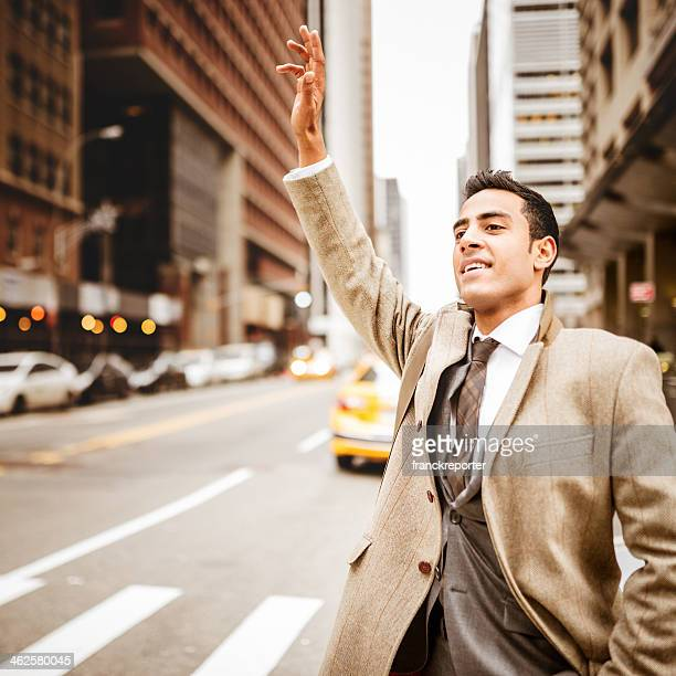 Businessman calling a taxi in new york city
