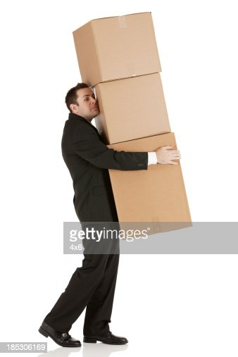 businessman carrying cardboard boxes stock photo getty images. Black Bedroom Furniture Sets. Home Design Ideas