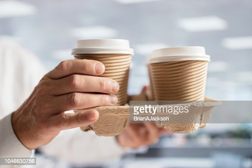 Businessman carrying coffee take out disposable cups in office for meeting : Stock Photo