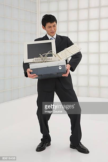 Businessman carrying computer