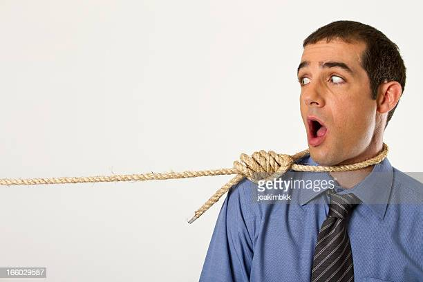 Businessman caught with a rope