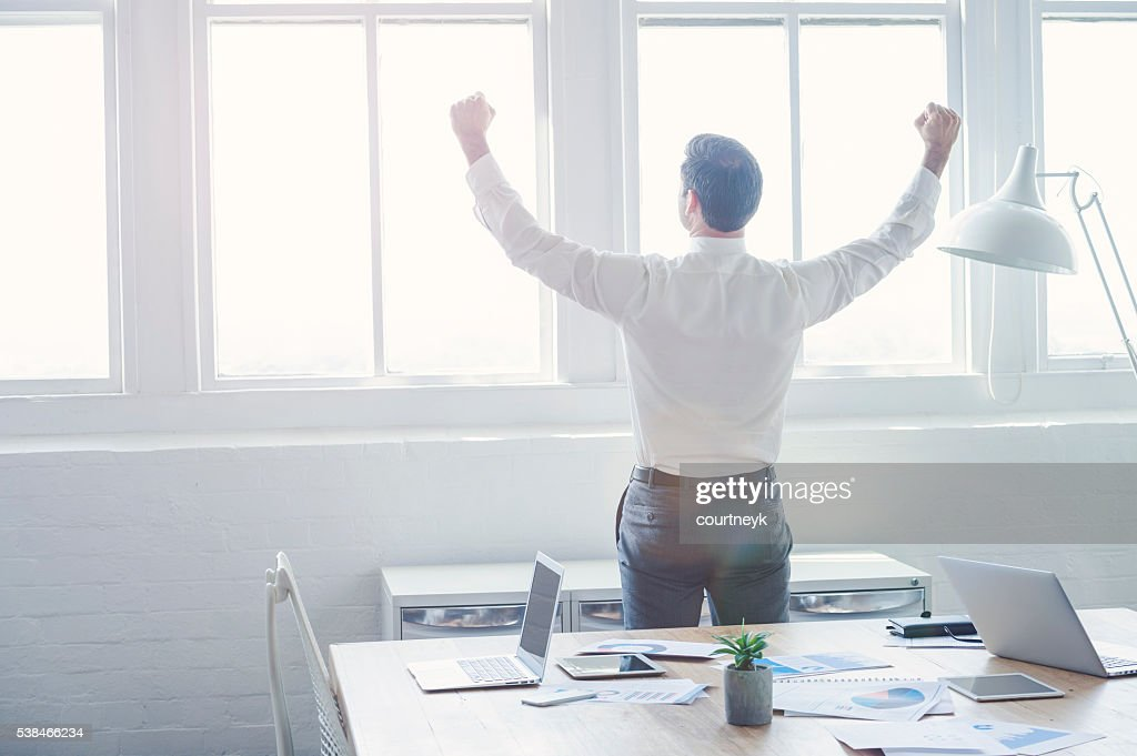 Businessman celebrating after a meeting. : Stock Photo