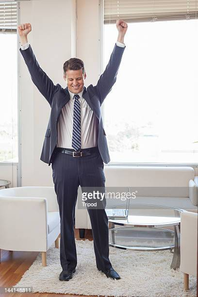 Businessman celebrating in office