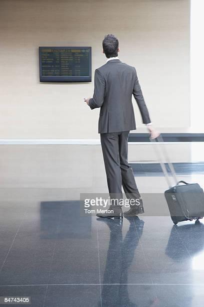Businessman checking flight times