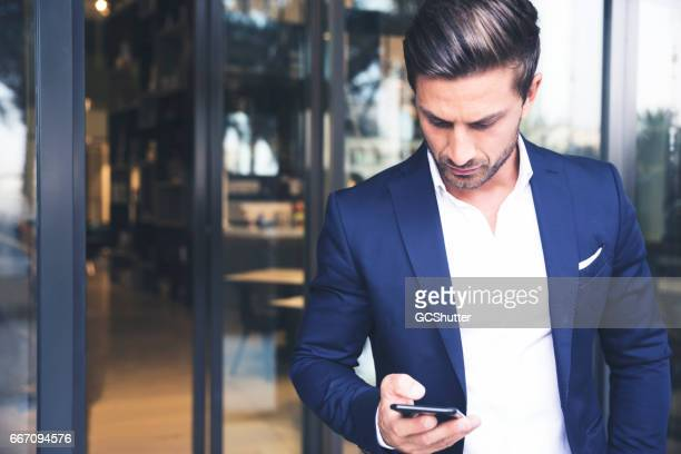 Businessman checking his email during his business travel