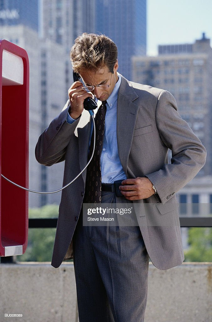 Businessman Checking His Pager