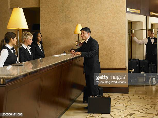 Businessman checking in at hotel desk