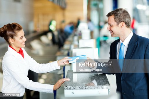 Businessman Checking in at the Airport