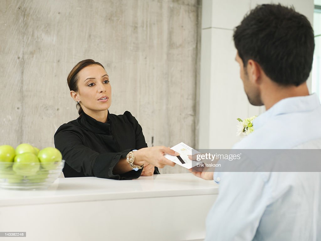 Businessman checking in to hotel
