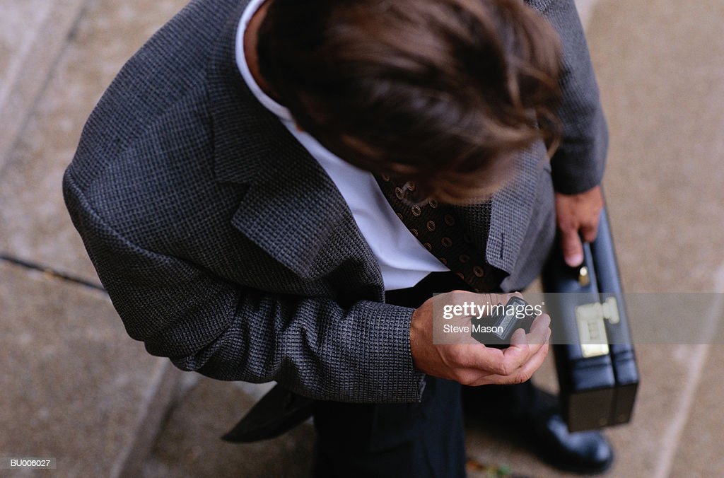 Businessman Checking Pager