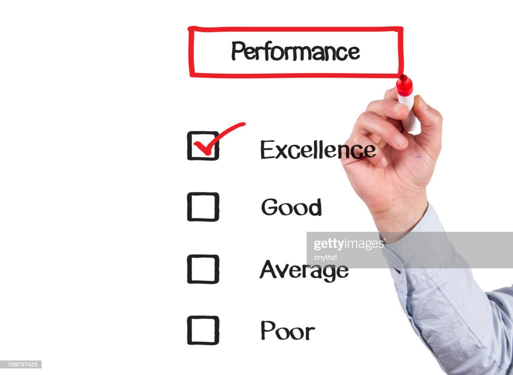 Businessman Checking Performance Form : Stock Photo