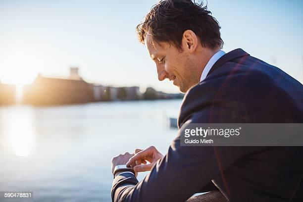 Businessman checking smartwatch.
