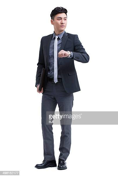 Businessman checking the time on wristwatch