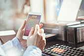 Businessman checks calendar on his smartphone application