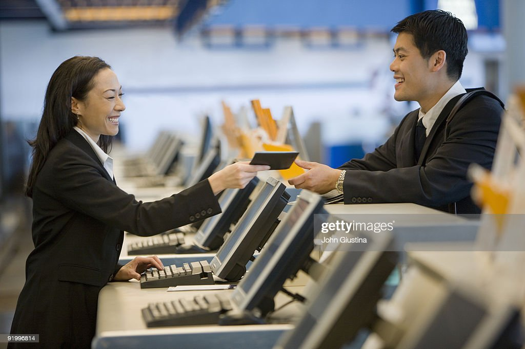 Businessman checks in at airport.