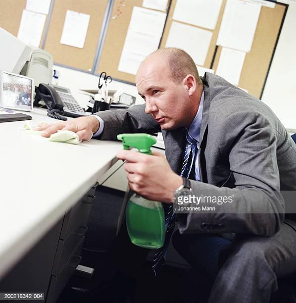 Businessman cleaning desk