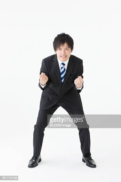 Businessman clenching fist