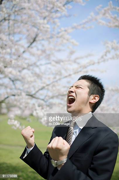 Businessman clenching fists, shouting