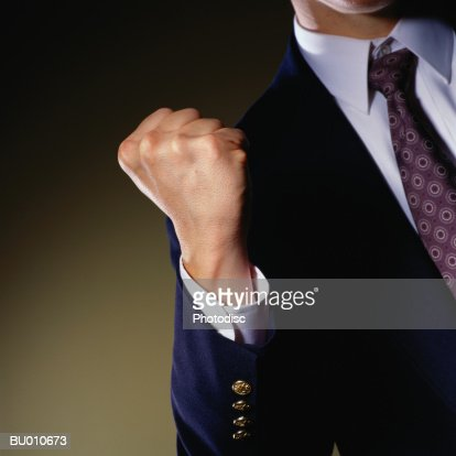 Businessman Clenching his Fist : Stock Photo