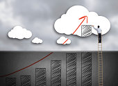 Businessman climbing ladder drawing growth chart on cloud, success in business concept