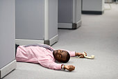 Businessman collapsed on floor in office