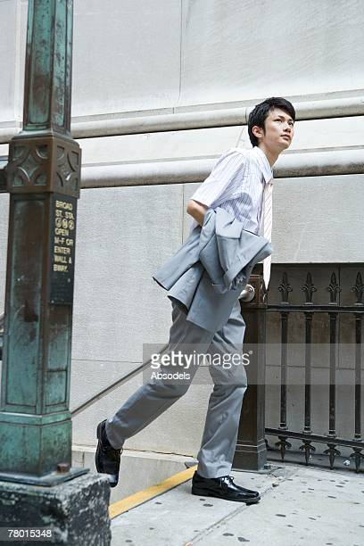 Businessman Coming Out From Station