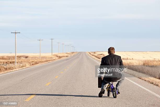 Businessman Commuting on Tiny Bicycle